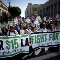 Fast food ranks protest for $15 an hour, take aim at election candidates