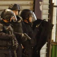 French police verifying if Paris attacks mastermind among two killed, seven arrested in dawn raids