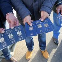Apparent Syrian passport found near Paris stadium attack points to lax refugee checks