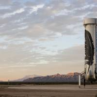 Bezos firm boasts reusable rocket, gets booster to return to Earth, land upright