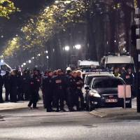 Hostages safe after apparent robbery-linked standoff in north France; no link with Paris attack seen