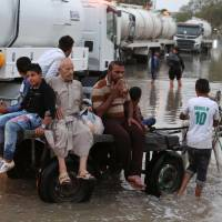Heavy downpours led to fatal electrocution of 58 in infrastructure-poor Iraq