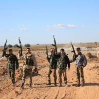 Aided by Russian airstrikes, Syrian troops break Islamic State's two-year siege of Aleppo base