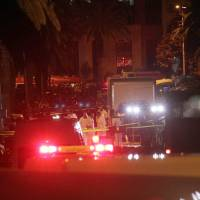 12 killed as apparent suicide bomber blows up Tunisia presidential guard bus
