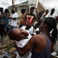 Haitians head to graveyards for Voodoo day of the dead
