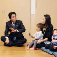 After visit to child care facility, Abe says he'll study reducing burden of pregnancy, childbirth