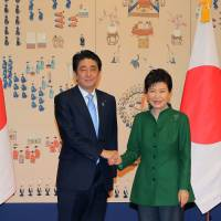 Abe, Park hold first bilateral talks since taking office, address 'comfort women' dispute