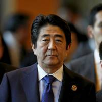 Abe raises South China Sea dispute at ASEAN
