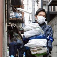 Kyoto deals with 'garbage house' by force