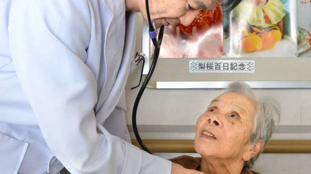 Public pensions, health care stretched as Japan's population ages