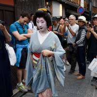Japan ups annual tourist target to 30 million as visitor numbers surge