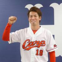 Carp ace Maeda seeks move to major leagues