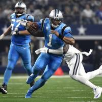 Panthers feast on Cowboys, now 11-0