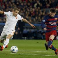 Messi on target again as Barca routs Roma