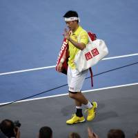 Nishikori retires with injury, hopes to be fit for London