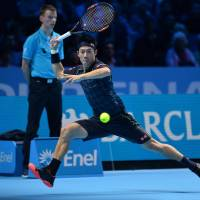 Nishikori edges Berdych; Federer downs Djokovic