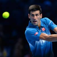 Djokovic beats Federer to win ATP World Tour Finals