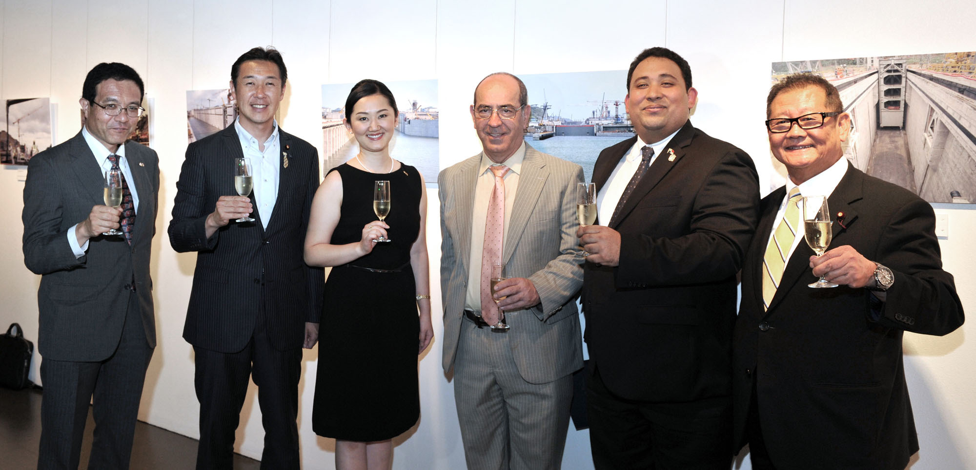 "(from left) Maritime Bureau of Ministry of Land, Infrastructure, Transport and Tourism Director-General Ichiro Hao; Parliamentary Vice-Minister for Foreign Affairs Hitoshi Kikawada; Ayana Hatada, wife of the Panama ambassador; Instituto Cervantes Tokyo Director Antonio Gil de Carrasco; Charge d'Affairs a.i. of Panama David De Leon; and House of Representatives member Tsuneo Akaeda prepare to toast at the opening of the ""Panama Canal: Expanding World Trade to the World'' photo exhibition, which runs through July 5, at Instituto Cervantes Tokyo on June 28. 