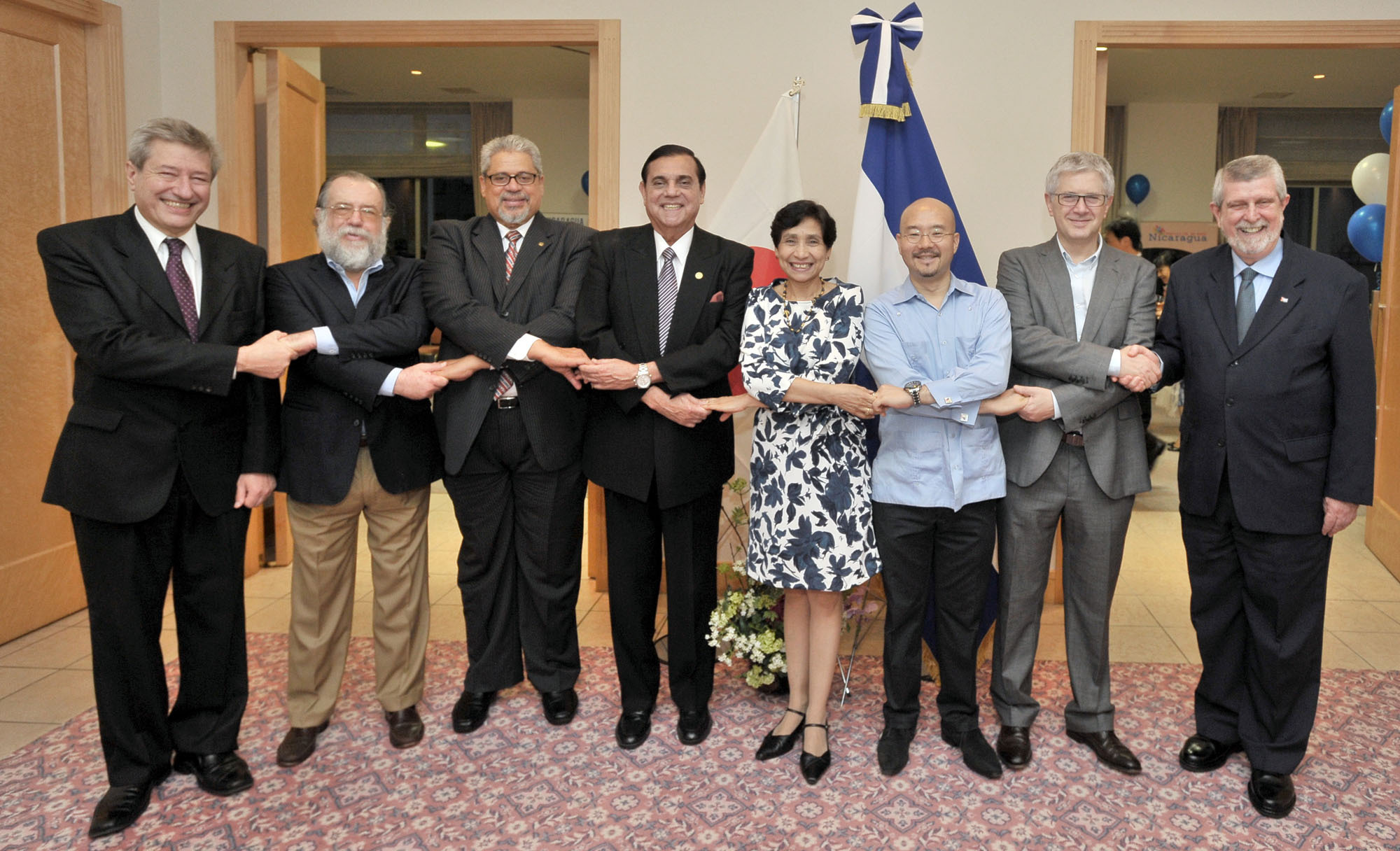 Nicaragua's Ambassador Saul Arana (fourth from left) joins (from left) ambassadors Eduardo Bouzout Vignoli (Uruguay), Leonardo Carrion Eguiguren (Ecuador), Hector Paulino Dominguez Rodriguez (Dominican Republic), Martha Zelayandia (El Salvador), Seiko Luis Ishikawa Kobayashi (Venezuela), Gabriel Duque (Colombia) and Marcos Fermin Rodriguez Costa (Cuba) during a reception celebrating the 195th National Day of the Republic of Nicaragua at the ambassador's residence in Tokyo on Sept. 17. | YOSHIAKI MIURA