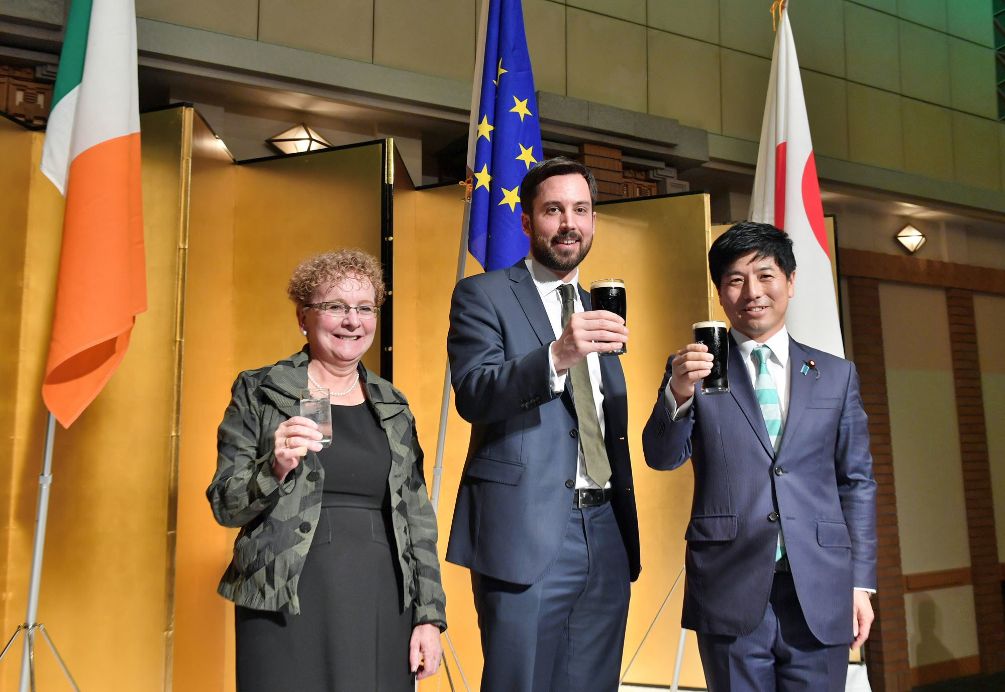 Irish Ambassador Anne Barrington (left), Irish Minister for Housing, Planning and Local      Government Eoghan Murphy T.D. and Kazuyuki Nakane, state minister for foreign affairs      poses for a photo during a reception to celebrate St. Patrick's Day at Imperial Hotel Tokyo on March 15. yoshiaki miura |