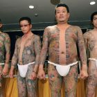 Gangster chic: Models show off works by tattooist Horiyoshii III at the Foreign Correspondents