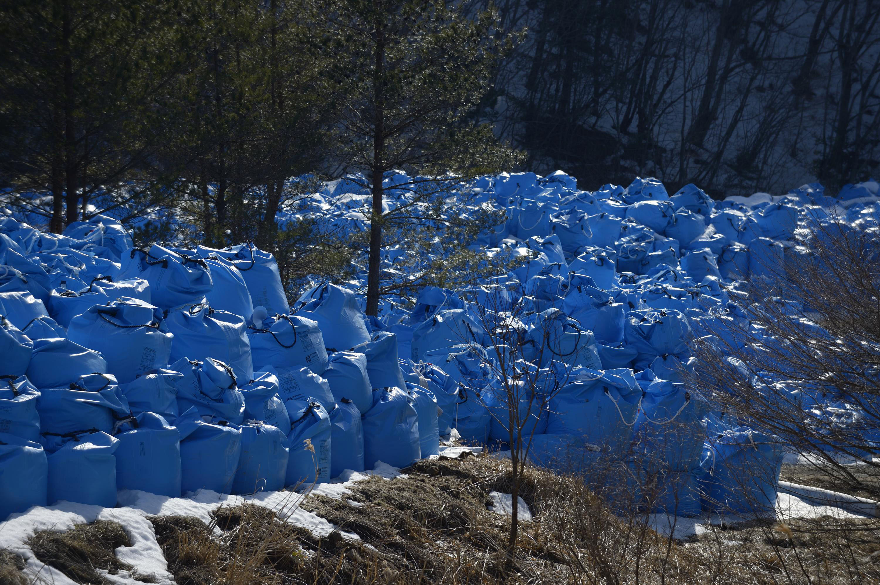 Bags containing waste left over after radiation decontamination are stored near Kawauchi, Fukushima Prefecture, on March 5.