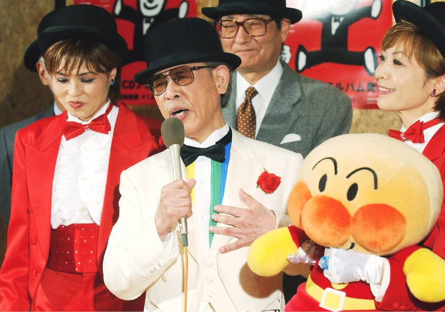 Takashi Yanase with his creation Anpanman.