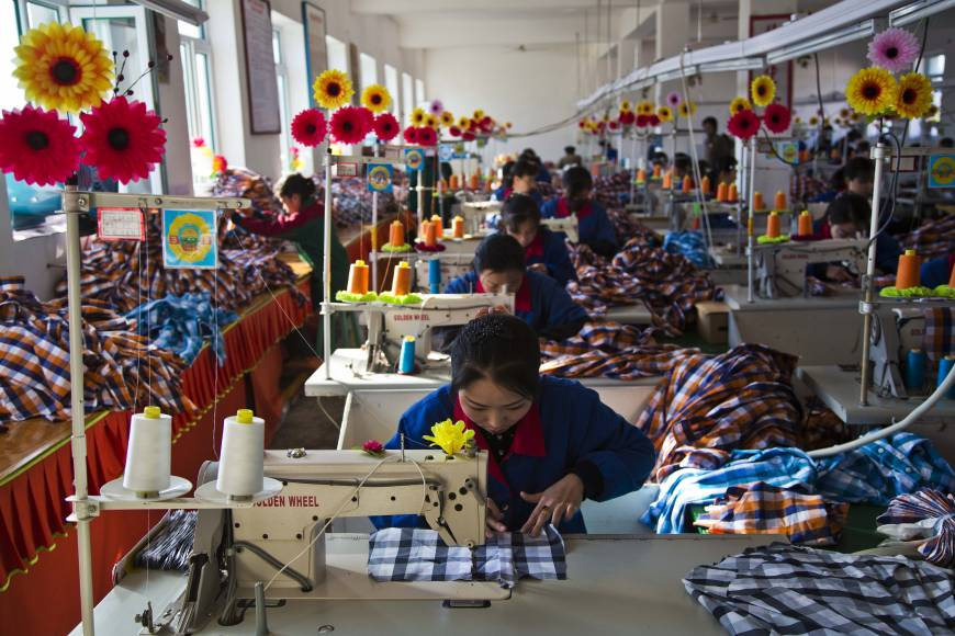 Hemmed in: Seamstresses work at the Sonbong Textile ...