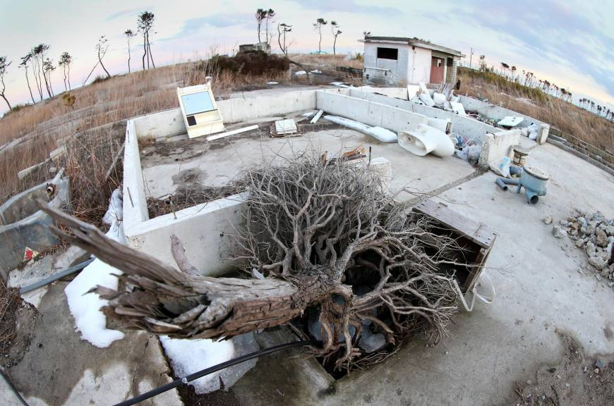 Foundations of houses that were washed away by the massive tsunami on March 11, 2011, lie abandoned in Wakabayashi Ward, Sendai, on Feb. 23. The disaster destroyed some 720 houses in the area, and the city plans to preserve some of the remains to keep the tragic memory alive.