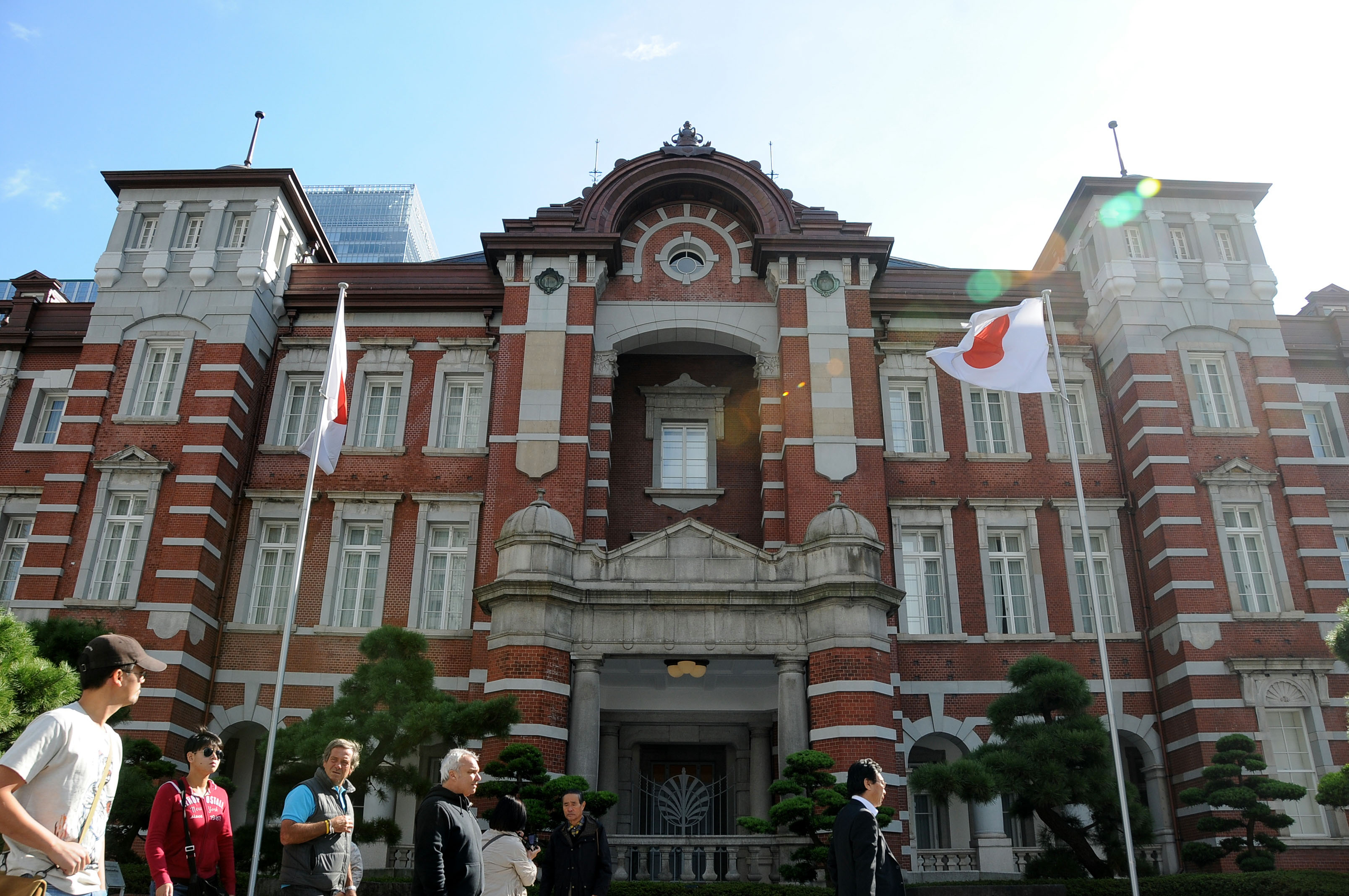Tourists walk past the front of the JR Tokyo Station building in the Marunouchi business district.