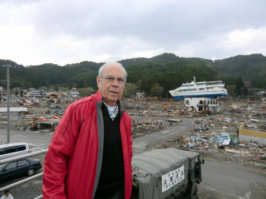Charles Pomeroy stands atop the seawall in the Akahama area of Otsuchi on May 4, 2011.