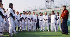 Team player: Shortly after creating the Sendai-based Tohoku Rakuten Golden Eagles baseball club in late 2004, Hiroshi Mikitani (left) visits its training camp at Fujiidera Baseball Stadium in Osaka.