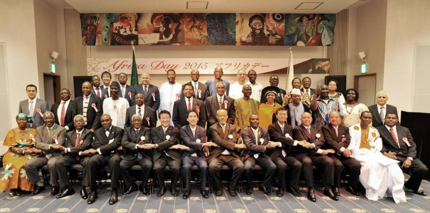 Dean of the African Development Corporation and Eritrea Ambassador Estifanos Afeworki (front row, seventh from right); State Minister for Foreign Affairs Minoru Kiuchi (seventh from left); Secretary-General, Japan-African Union parliamentary Friendship League Asahiko Mihara (sixth from left); President of the National Assembly of Djibouti Mohamed Ali Houmed, (sixth from right); Director-General, Affrican Affairs Depaartment, Ministry of Foreign Affairs Norio Maruyama, (fifth from right); and Lesotho Ambassador and Chair of the Africa Day Reception 2015 Richard Ramoeletsi (fourth from right) pose with other ambassadors, and Diet members during a reception to celebrate Africa Day at the Angolan Embassy in Tokyo on May 26.