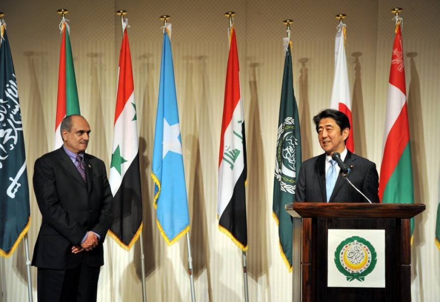 Prime Minister Shinzo Abe speaks while the representative of the Permanent General Mission of Palestine and dean of the Arab diplomatic corps, Waleed Siam, looks on during an Arab Week reception and in celebration of Arab-Japan friendship at the Mandarin Oriental hotel in Tokyo on April 6.