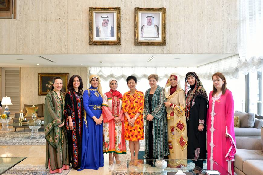 The Society of Wives of Arab Ambassadors and Heads of Missions in Japan (SWAAJ), including Qatar's Jamila Al-Suwaidi (third from left), president of SWAAJ), Kuwait's Jamilah Al-Otaibi (fourth from left) and other SWAAJ members, host a luncheon in honor of Princess Takamado (center) at the Kuwait embassy in Tokyo on May 14.