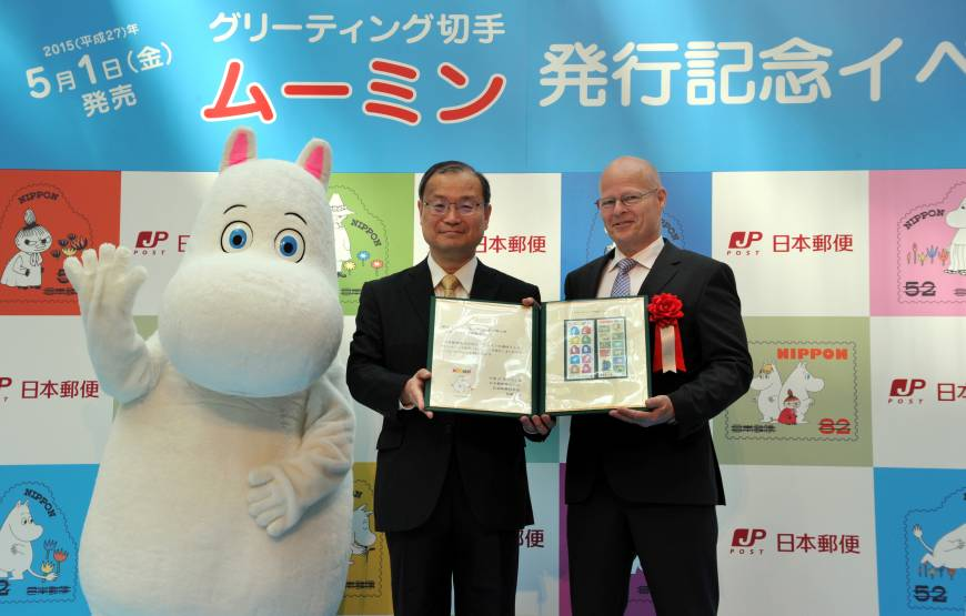Finland Ambassador Manu Virtamo (right) receives Moomin Postage Stamps from Japan Post Co. President and CEO Toru Takahashi (center), during an event celebrating the issue of Moomin Postage Stamps