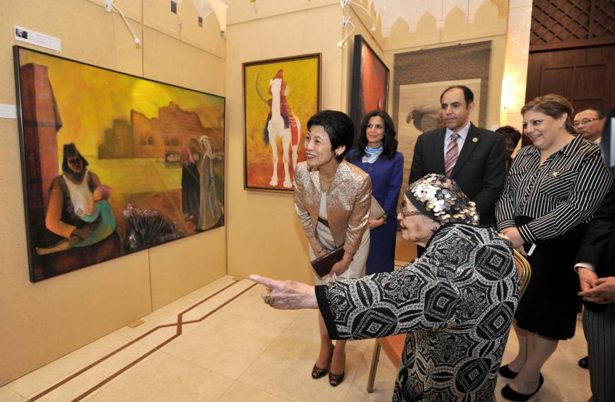 Artist Kazuko Irie (foreground) explains her painting to Princess Takamado (left) while (from left) Maali Siam, wife of the representative of the Permanent General Mission of Palestine, Oman Ambassador Khalid al-Muslahi and his wife, Abeer Aisha, look on at the opening of