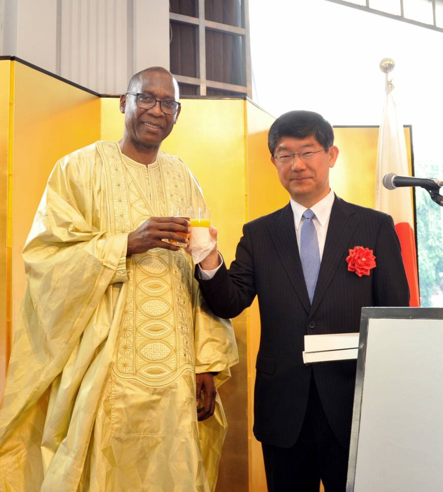 Senegal Ambassador Cheikh Niang (left), shares a toast with Ambassador in charge of RECs, Peace and Security in Africa Hiroyasu Kobayashi, during a reception to celebrate Senegal's 55th National Day at the New Otani Hotel in Tokyo on May 25.