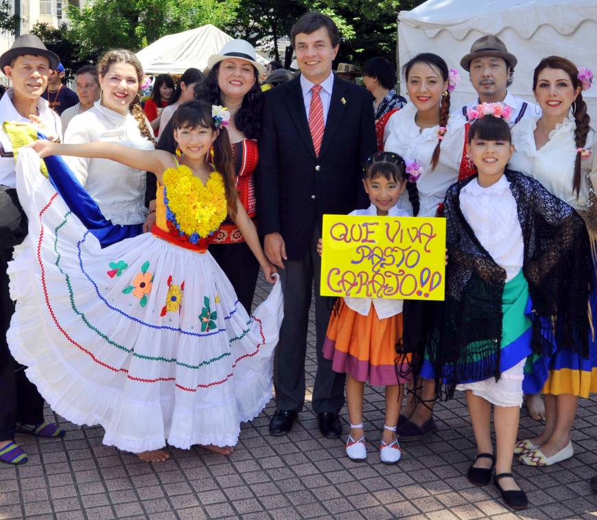 Colombian Ambassador Roberto Velez (center) poses with the Colombian dance troupe