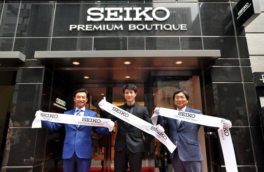 From left, President and CEO of Seiko Watch Corp. Shinji Hattori, singer and actor Wang Leehom and President of WAKO Co. Tatsuhiko Adachi take part in a ribbon-cutting ceremony at the company