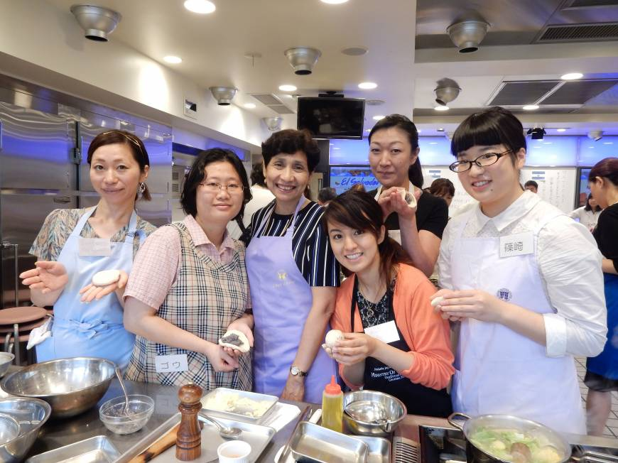 El Salvador Ambassador Martha Lidia Zelayandia (third from left) poses with students during a lesson on traditional Salvadorian cuisine at Hattori Nutrition College on July 4.