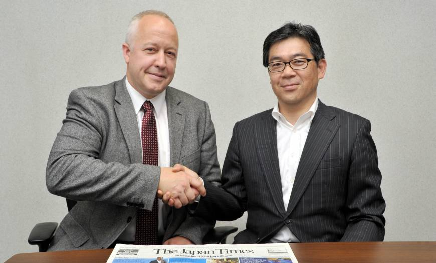 Kent D. Lee, president and CEO of East View (left), visited The Japan Times on June 5 to mark his company