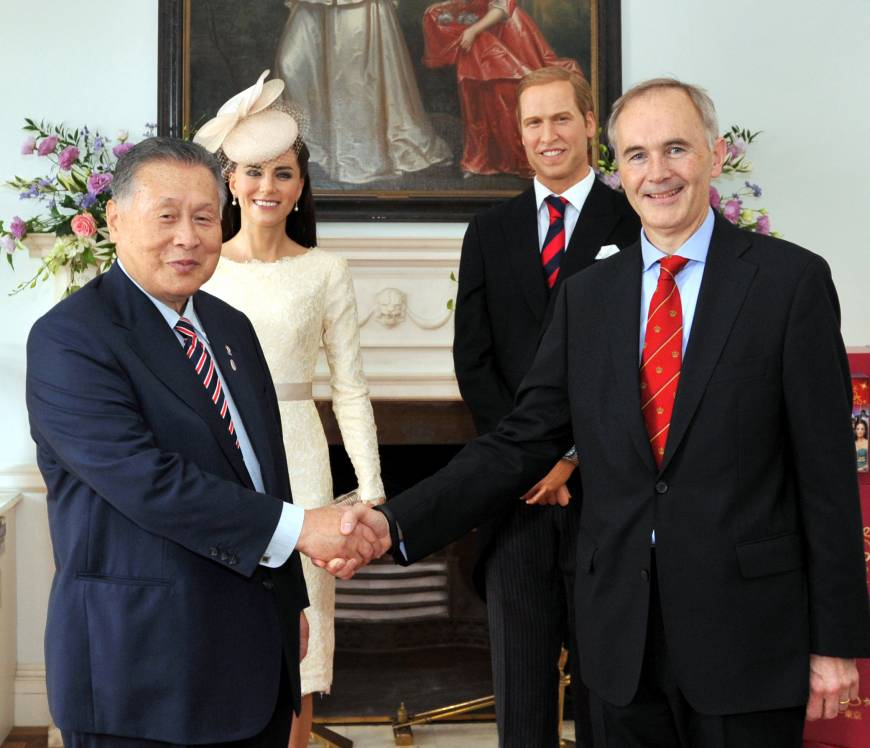 British Ambassador Tim Hitchens (right) shakes hands with former Prime Minister Yoshiro Mori during a reception to celebrate the birthday of Her Majesty Queen Elizabeth II at the ambassador