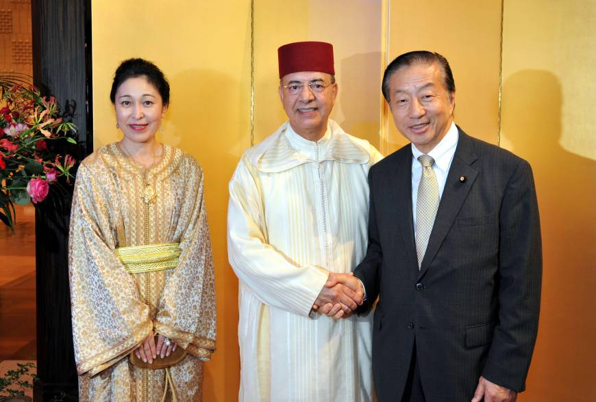 Moroccan Ambassador Samir Arrour (center) and his wife, Utako, welcome President of the Japan-Morocco Parliamentary League Kenji Kosaka, at a national day reception to celebrate the 16th Anniversary of the Enthronement of his Majesty King Mohammed VI at the Hotel Okura, Tokyo on July 30.