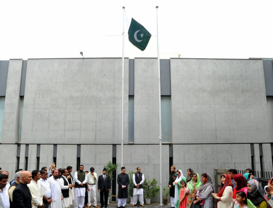 A group attends a flag-raising ceremony at the Pakistan embassy in Tokyo on Aug. 14, during a ceremony to celebrate the country