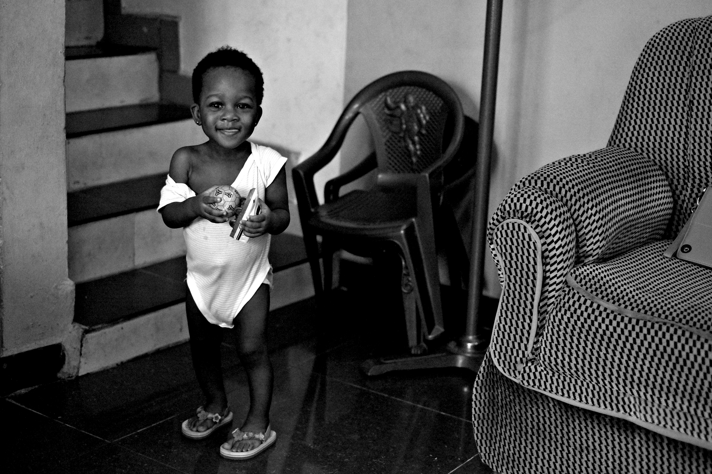 Paul's daughter plays with a toy shinkansen at home in Nigeria in 2014.