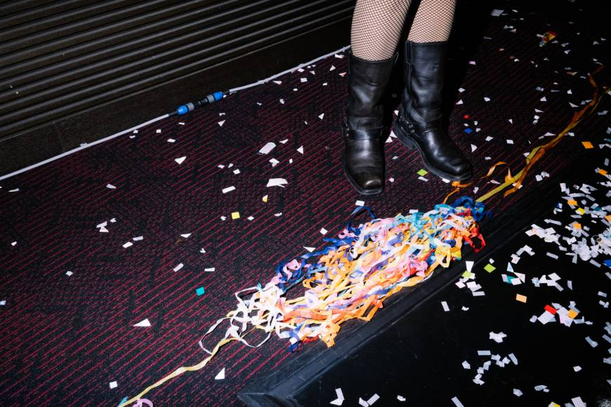 The party may be over, but the Lip's members stay on to make sure the theater is spotless before they leave.
