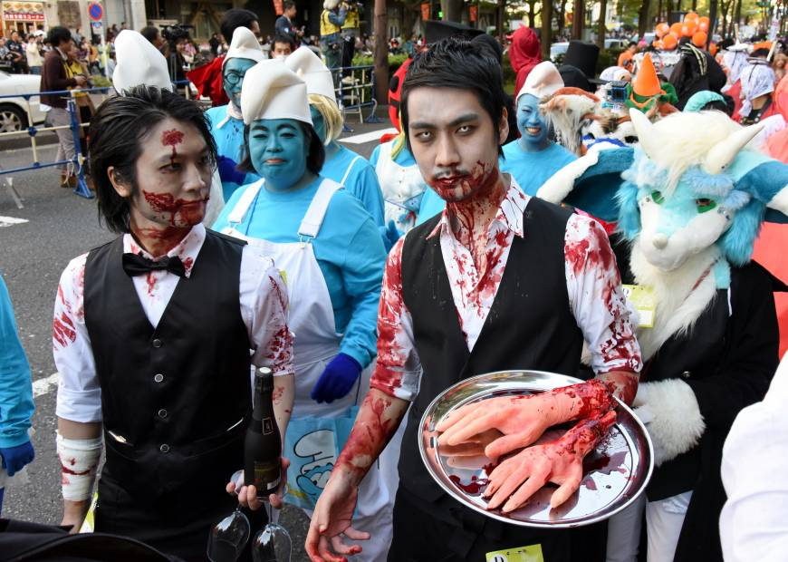Need a hand with that? Zombie service at the annual Kawasaki Halloween Parade, which attracted about 2,500 participants on Sunday.