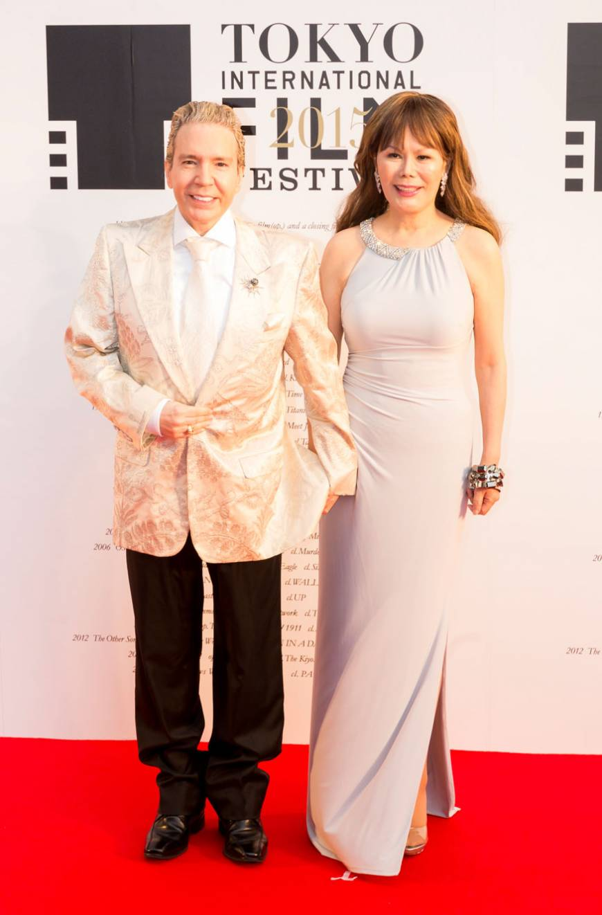 TV celebrity Dave Spector and his wife, Kyodo, pose before the opening ceremony of the 2015 Tokyo Film Festival.