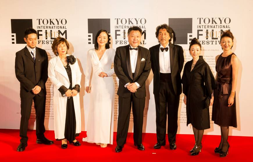 Masato Harada (fourth from left), director of